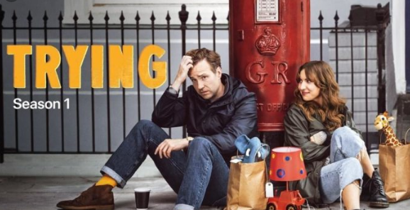 A fun British comedy revolving around a couple who are unable to conceive, and follow the path of adopting. 'Trying' stars Rafe Spall and Esther Smith.